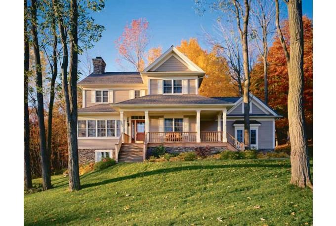Неброский дизайн загородного дома на фото в стиле кантри напоминает сельские фермерские дома викторианской эпохи Англии