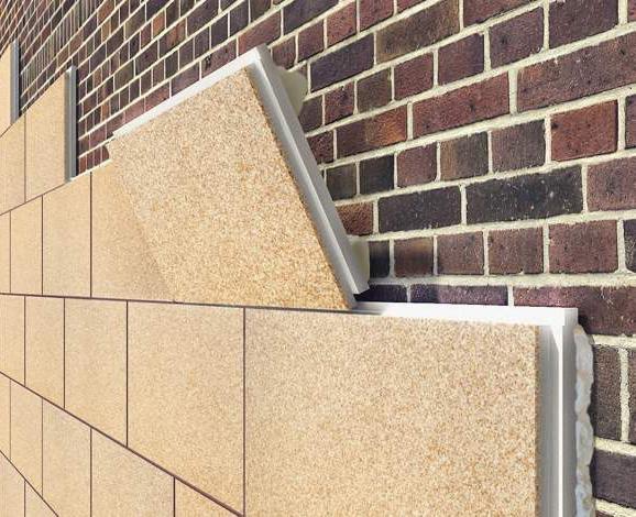 Фото: установка термопанелей на кирпичную стену