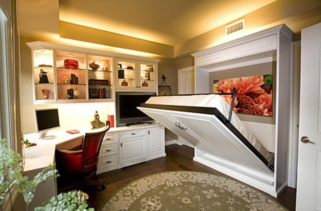 Складная кровать в интерьере однокомнатной квартире помогает существенно сэкономить квадратные метры