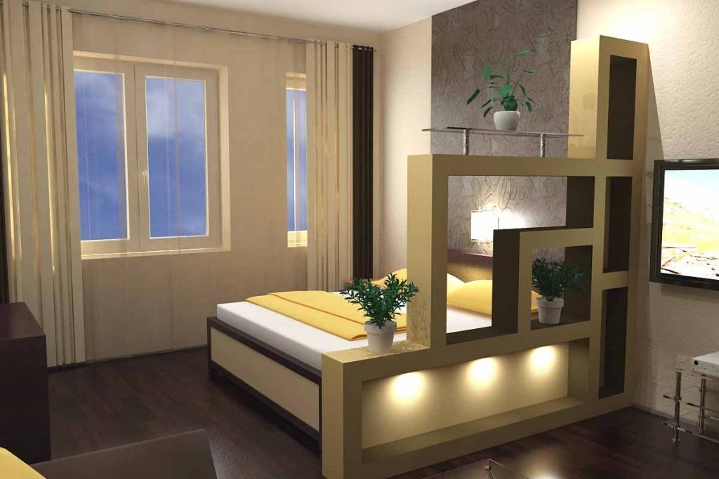 Интерьер, в котором спальная зона отграничено полками особой конструкции