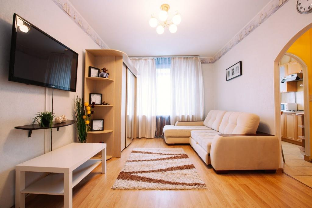Дизайн однокомнатной квартиры, в которой двери заменены арками