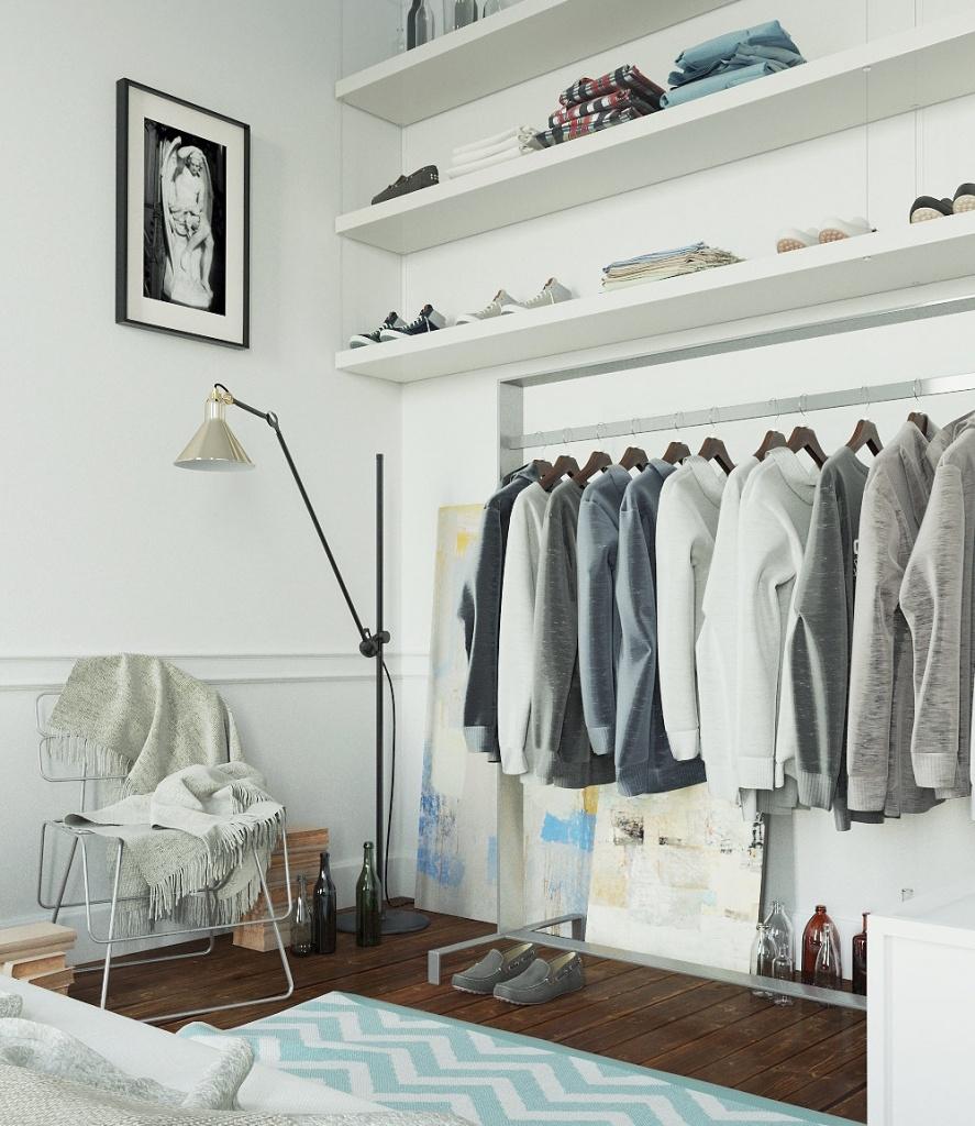 Открытый гардероб в спальне экономит место за счет отсутствия дверей